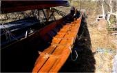 Halfdan ordner båten som er på over siden av fossen i Karasjohka